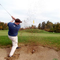 Stinky Golfer Chris in the trap...yes that's the ball still in there... (photo by Greg D'Andrea)