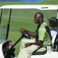 Michael Jordan puffing a stogie on the golf course (photo by shgmom56 / CC BY-SA 2.0)