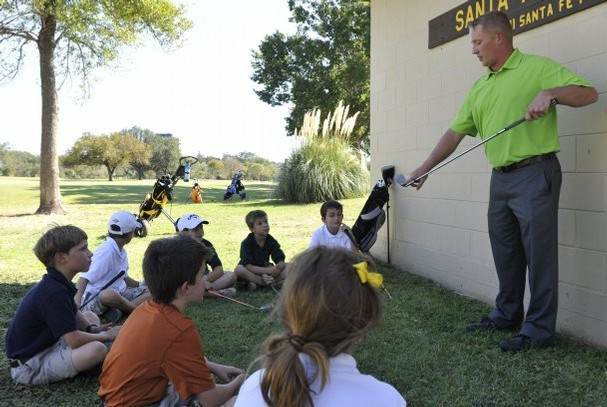 Mr. Gaestel teaching junior golfers.